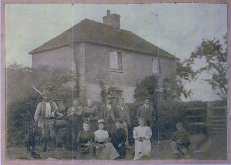 The Lucas family outside their house, Rusketts (long since demolished) in Lower Haysden in about 1900.  John Lucas, a farm worker and gamekeeper, is on the left (b. 13 April 1851 in Leigh), his wife Elizabeth and another older lady are next to him.The others, their surviving children, include Susan (b. 1879), Lucy (b. 1880), John (b. 1881), Henry (b. 1882), Joseph (b. 1886), Simeon (b. 1888) and Victoria (b. 1889). In the 1901 census all the boys were recorded as 'farm labourers' and all the girls 'servants'.  John Lucas was said to have been killed when struck by lightning.