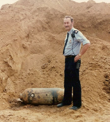 PC Bob Woolett with an unexploded bomb found on Hever Golf Course