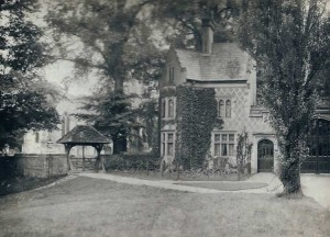 East Lodge and Lych Gate. Note the gas light to the left, and large tree (oak?) to right of the lych gate