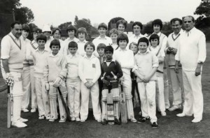 Colin Cowdrey's visit to coach Leigh Cricket Club Juniors on Leigh Green, 24 June 1981. Adults are Colin Cowdrey (left), John Knock and Tony Sadler (right)