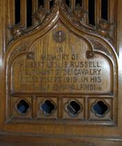 Hubert Leslie Russell is commemorated on a carved prayer-desk in St. Mary's Leigh.