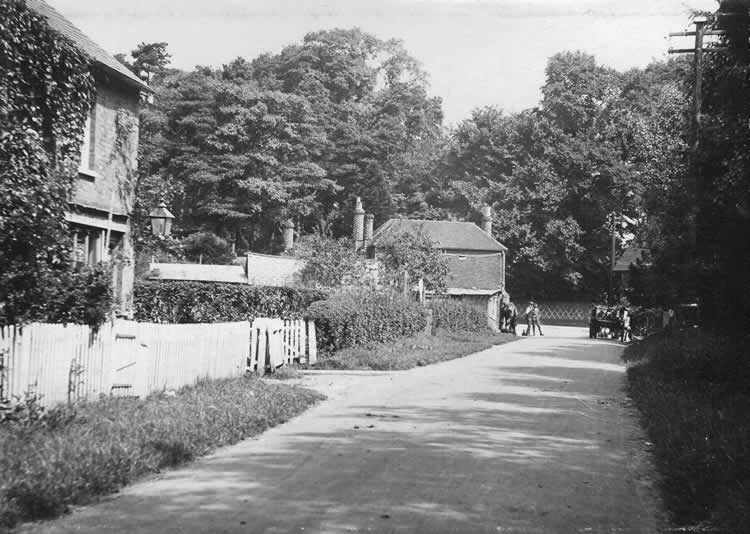Lower Green, looking towards the High St. with the Bakery on the left and The Brickmaker public house in the centre, c. 1920