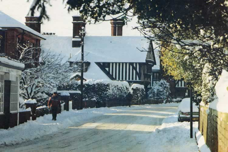 High Street in Winter. Christmas card produced 1990