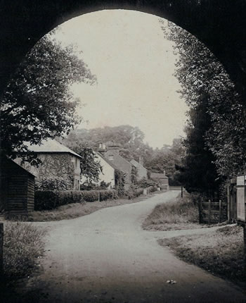 Lower Green through the Railway Bridge. Photograph from the album of Rev. Octavius Walton (vicar of Leigh 1906-18)