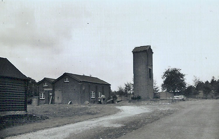 Probably the Water Tower at the Powder Mills site. Demolished in 1960s. Photo July 1963 in Historical Society Archive.
