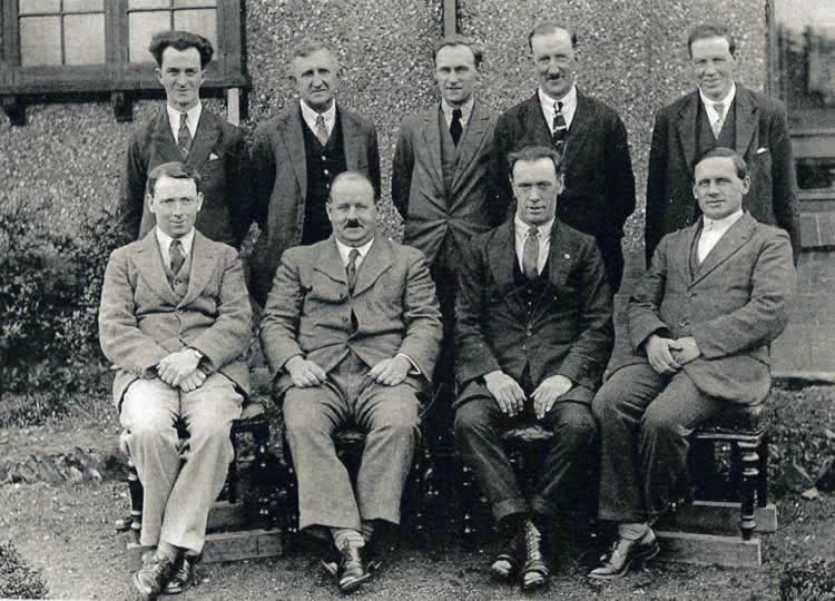 Back row, left to right: C or T Lee; unknown; unknown; Frederick Fitzjohn (foreman); Mr Hills (under manager) Front row, left to right: Charlie Hayter (tester); Mr Evelyn (manager); unknown; unknown Note: on the photo, as is usual in this period, the working men are given christian names and managers are called 'Mr'. John Evelyn was the manager of the whole gunpowder mills from 1920 until 1934 when the works were moved by ICI to Scotland. John Evelyn and a few of the other workers moved to Scotland.