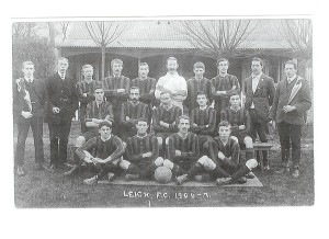 Names from left-right: Back: Sid Hitchcock; Jerry Robinson; Harold Hounsome; Ted Squires; Fred Faircloth; Fred Fitzjohn (goalkeeper in white); Bert Stubbings; Nim Faircloth; Referee; Harry Bowles Centre: George Jempson; Fred Parker; Tom Parker; Ratty Brooker; Frank Faircloth Front: Harold Young; Noel Jempson (Jemphson); Jack Stolten; George Faircloth
