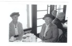 Left: Mrs Phoebe Card; right Mrs Emily Fitzjohn, taking tea on Gold Years Club Outing early 1960s