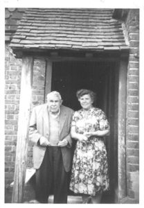 Albert Charles (Bert) Humphrey and daugther, Mabel, outside 2 Waterworks Cottages