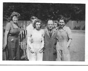 Barbara Faircloth in middle; with Mr Moon - and his war effort girls.  Approx 1942.