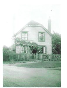 Oak Cottage during Second World War - see tape across window panes. Also second chimney on right - south side - demolished ?1950s - not clear in this picture. Downstairs windows were arched as in existing north window upstairs. Also open porch/tiled canopy.