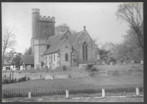 Leigh Church, taken after 1913 when the charity cottages in this area of garden next to South View had been pulled down.  Photograph from the album of Rev. Octavius Walton Vicar of Leigh 1906-18)
