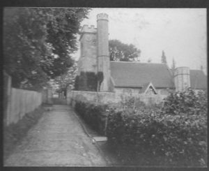 hurch Hill - another view up to Church.  This time you cannot see the cottages on the right hand side but just the entrance to the garden. Photograph from the album of Rev. Octavius Walton Vicar of Leigh 1906-18)
