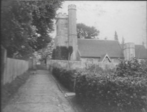 Church Hill.  From album of Rev. Octavius Walton Vicar of Leigh 1906-1918).  View does not show the cottages on the right hand side, just entrance gate to them.