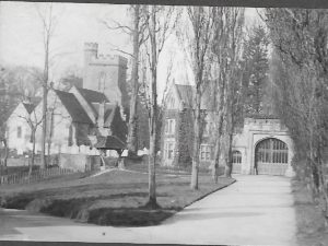 View of East Lodge and Church ca 1910, showing picket fence at side of what is now part of garden at South View