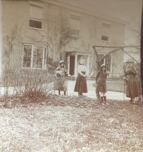 Outside the Woods: 2nd left Maud Heath; on right possible Agnes Maria Heath, others not known