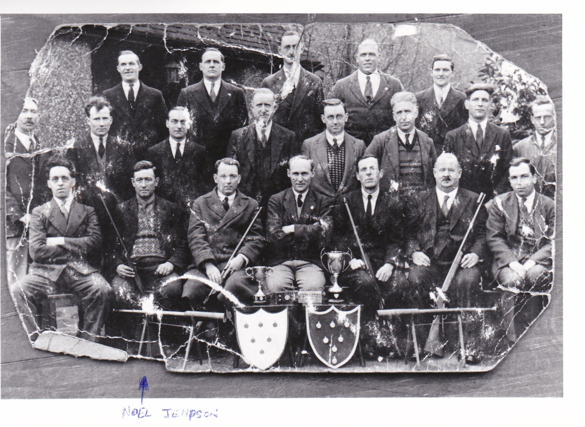 Powder Mills Rifle Club, winners of the KCRA Kilara Cup: the Tonbridge and District Miniature Cup; and the Robinson Challenge Cup.  Noel Jempson, publican of The Plough, is bottom row, second from left - see arrow.   Alfred Batchelor is top row fourth from left, when looking straight at the picture.